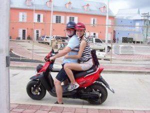 riding scooter in Roatan
